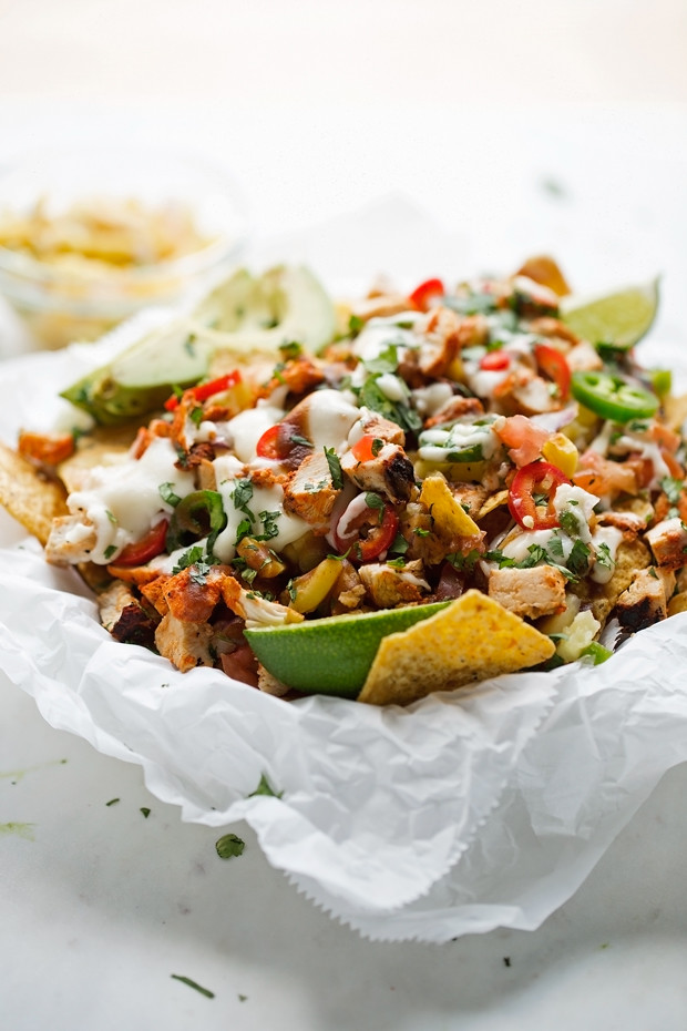 Loaded Tandoori Chicken Nachos - made with tandoori spiced chicken, homemade cheese sauce and tons of pico de gallo! Perfect for game day! #tandoorichicken #nachos #football #gameday | Littlespicejar.com @littlespicejar