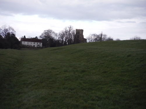 Grassy slope on approach to All Saints Church, Wing