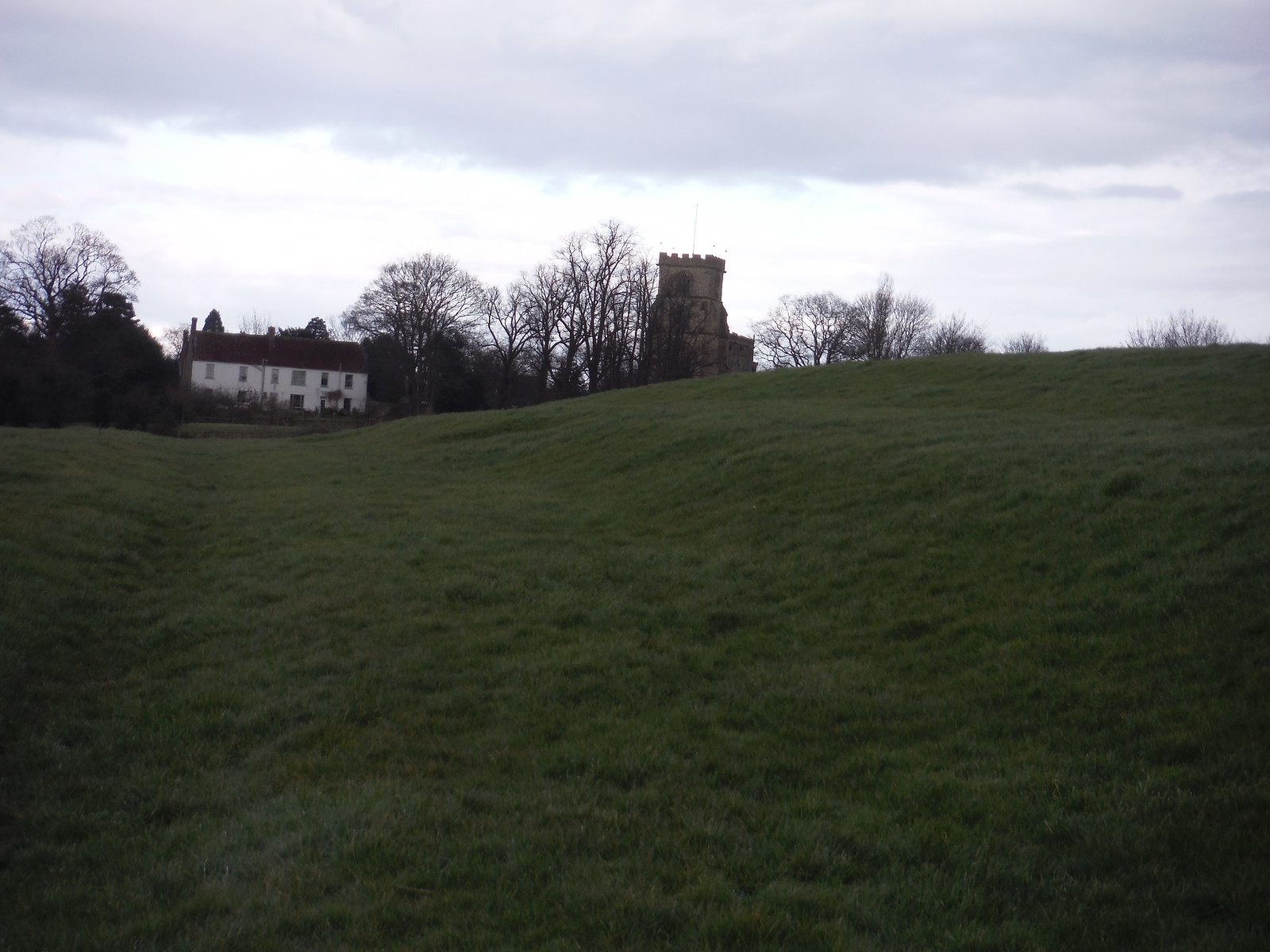Grassy slope on approach to All Saints Church, Wing SWC Walk Cheddington to Leighton Buzzard