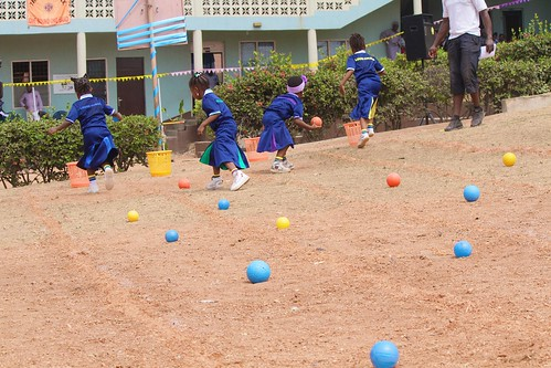 Younger students competing in the 'Pick up the Ball' game at the Louisville Nursery and Primary School, Ibadan, Sports Day