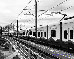 Black & White of A Three-Car Central Link Consist Pulling Out of Mount Baker Station