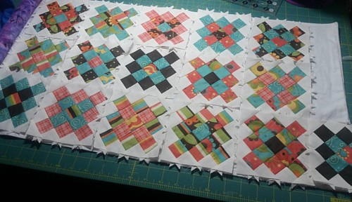 All 16 scrappy granny square blocks. Now how do I set them?