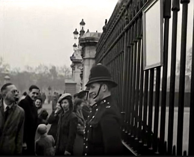 November, 1948. Buckingham Palace, Westminster, London, SW1. UK.  Smiling London Metropolitan Police Constables  Monitor The Public Announcement Of The Birth Of HRH Prince Charles On The Railings Of The Palace.