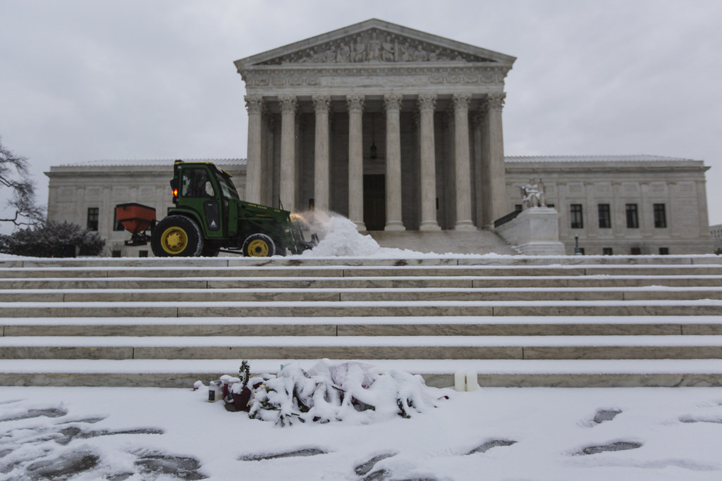 A Snowy Scalia memorial at the foot of the Supreme Court steps
