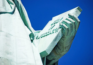 Image of  Statue of Liberty  near  City of Jersey City. tablet statueoflibertyny roncogswell tabletstatueoflibertynewyorkharborny statueoflibertynewyorkharborny libertyislandnewyorkharborny