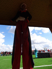 stilt man in tent full length