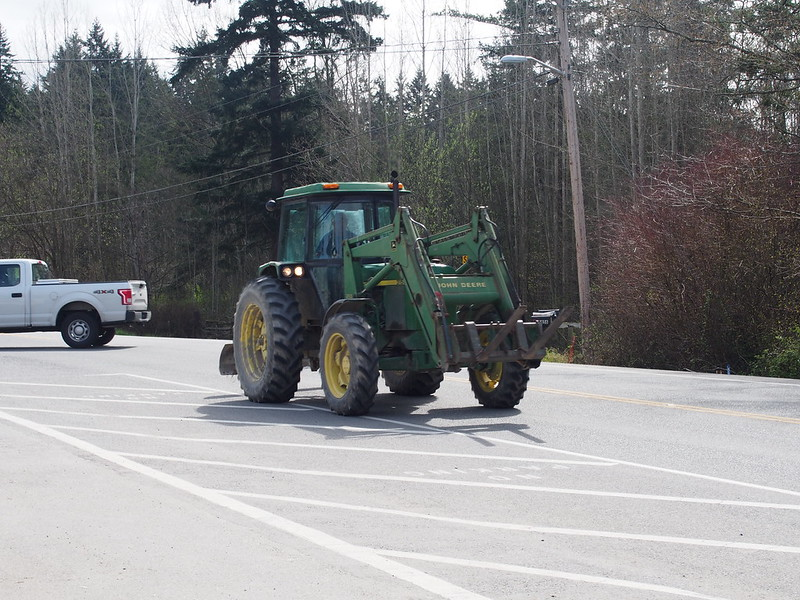 Tractor: This guy went by while I was stopped at the Rexville Grocery.  I eventually caught up with it and was stuck behind it in a line of cars.A little after passing it, I made a left onto another road
