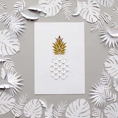 white kirigami pineapple with tropical paper cut leaves