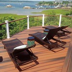 DuraLife decking in Brazilian Cherry with White Railways railing post and custom cable railing infill