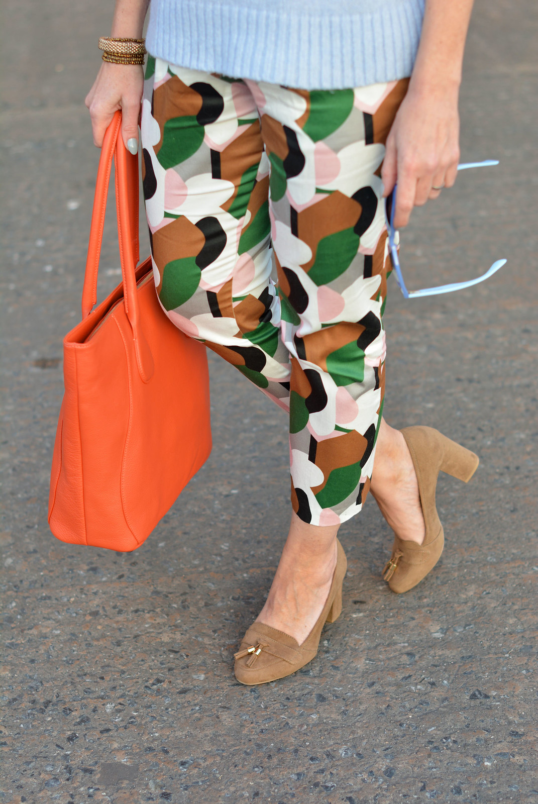 Spring style: Bold patterned pants, pale knit, orange tote | Not Dressed As Lamb