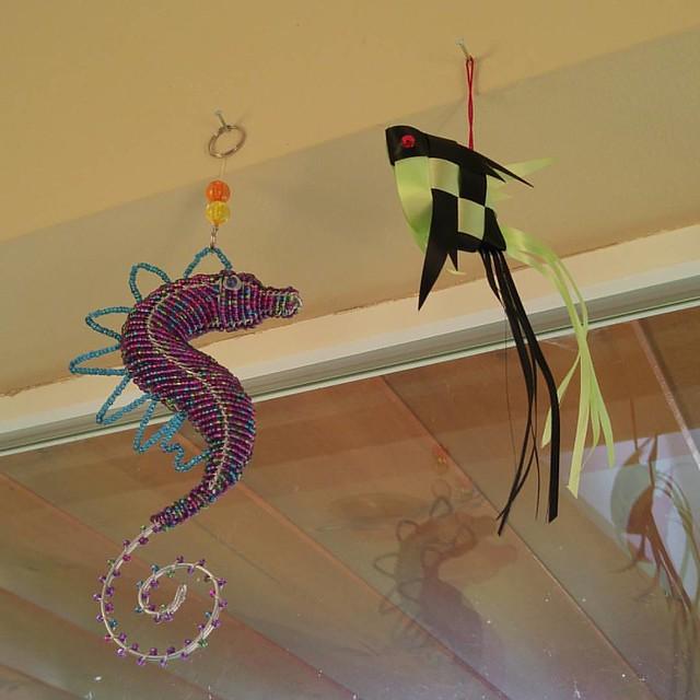 Bead seahorse from Kona, ribbon fish from Kalaheo.