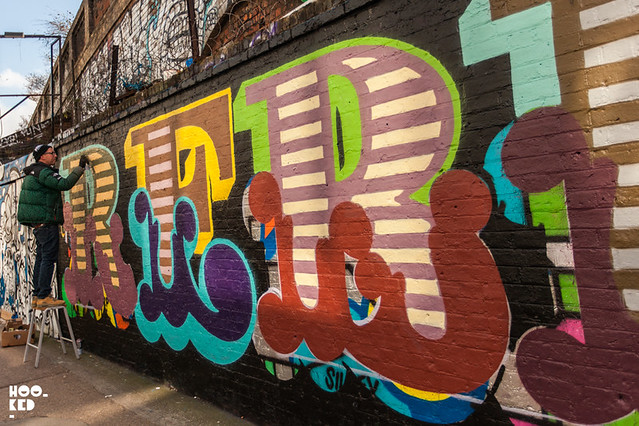 Brick Lane Street Art by British street artist Ben Eine, titled 'REBEL REBEL'