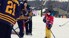 Outside hockey on ice with the big boys