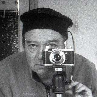 reflected self-portrait with Diax camera and black sequined hat (square crop)