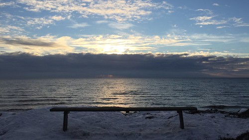 ocean winter sunset snow water glass clouds bench looking view sweden through halland