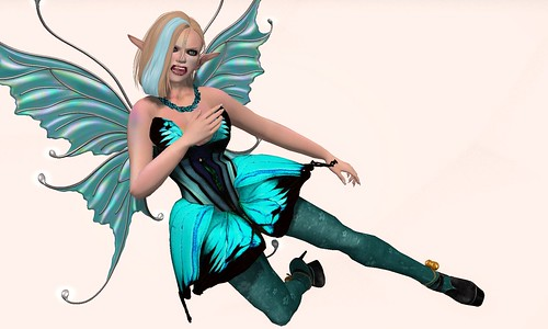 Image Description: Deoridhe dress in teal leaps from left to right in a flying kick.