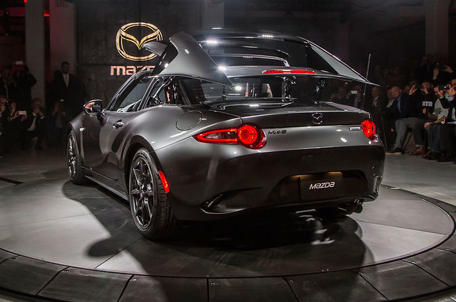 2017-Mazda-MX-5-Miata-RF-on-stage-rear-side-view-top-folding