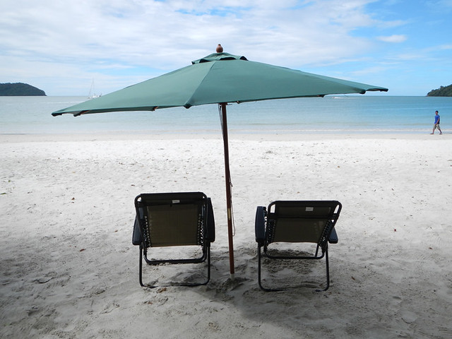 Empty Beach Chairs and Umbrella on the beach in Langkawi, Malaysia
