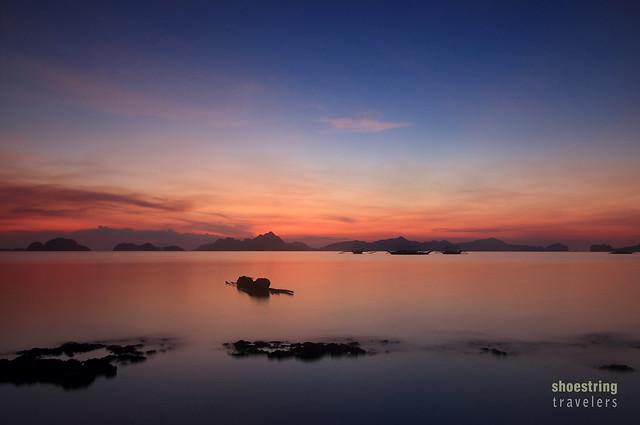 sunset at Bacuit Bay viewed from Corong Corong Beach