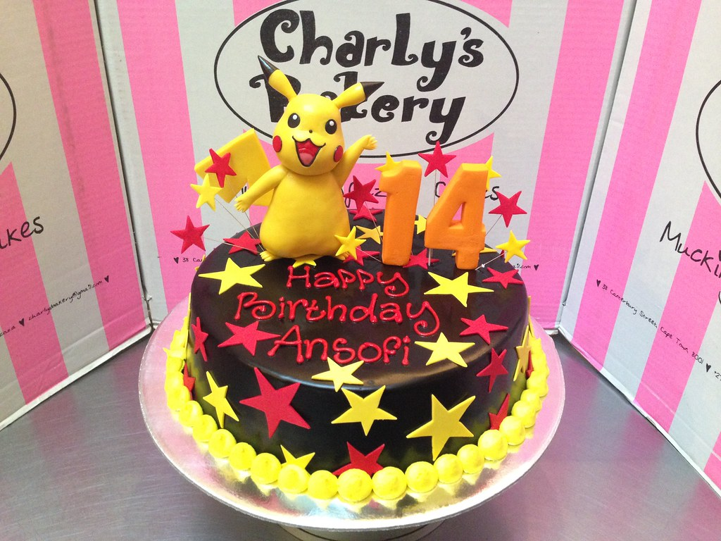 Pikachu Themed 14th Birthday Cake With 3D Figurine On Top And Stars All Over
