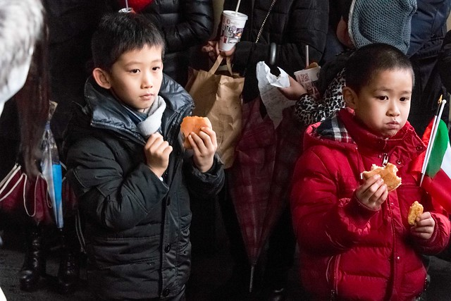 Chinese kids celebrating in Italy eating cheeseburgers.