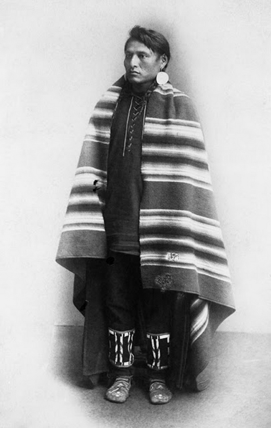 Blackfoot man wearing poncho