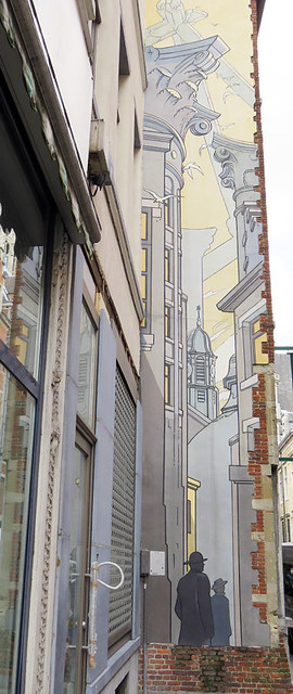 One of many cartoon murals on a wall in Brussels, Belgium
