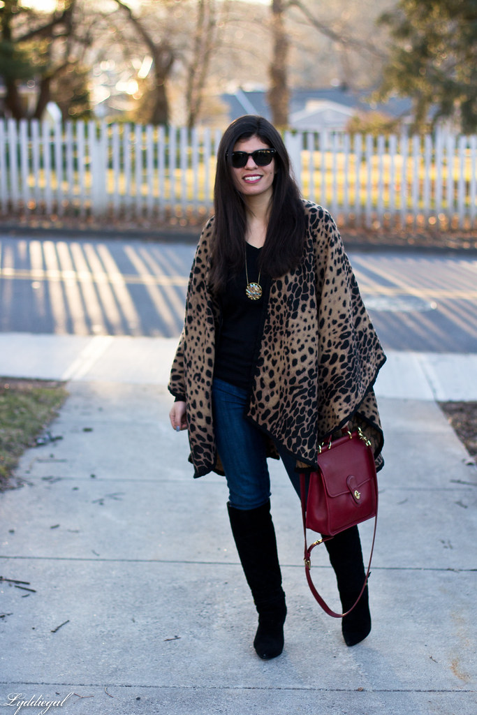 leopard poncho, black tee, black boots, red coach bag.jpg
