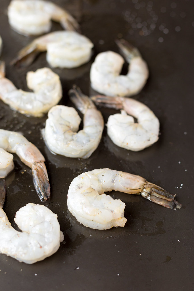 raw shrimp on baking pan
