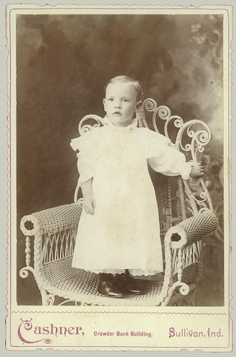 Cabinet Card Baby standing in Rattan Chair