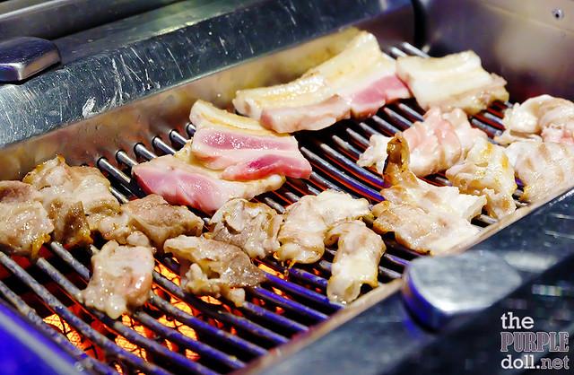 Grilling meats at KPUB