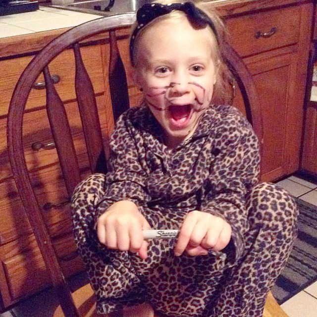 "While visiting her grandparents...""Look! I'm a cat!"" A cat with a sharpie face, of course. Thank goodness she stayed over there tonight!  #adventureswithlily"