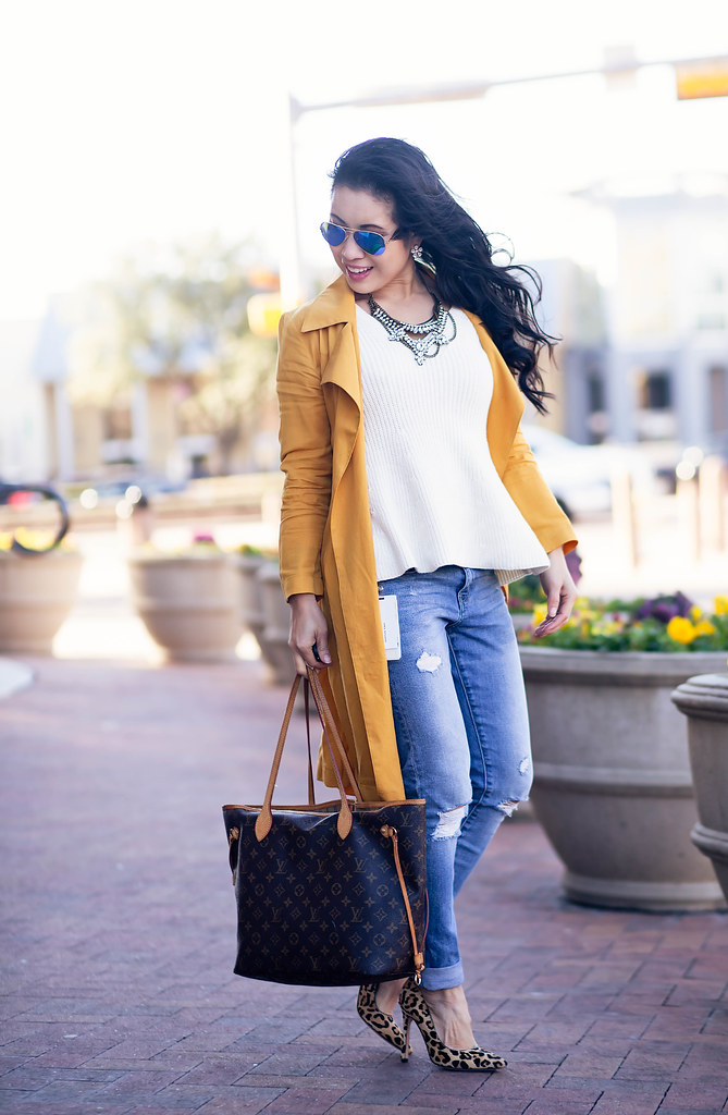 cute & little blog | mustard waterfall drape trench coat, white peplum knit sweater, distressed boyfriend jeans, leopard pumps, rayban blue mirror flash aviators, louis vuitton neverfull mm | spring outfit