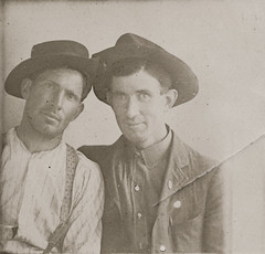 Photo booth portrait of two men wearing hats