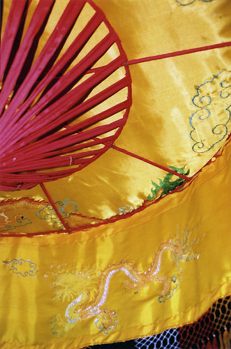 A red and yellow silk umbrella in a Vietnamese temple