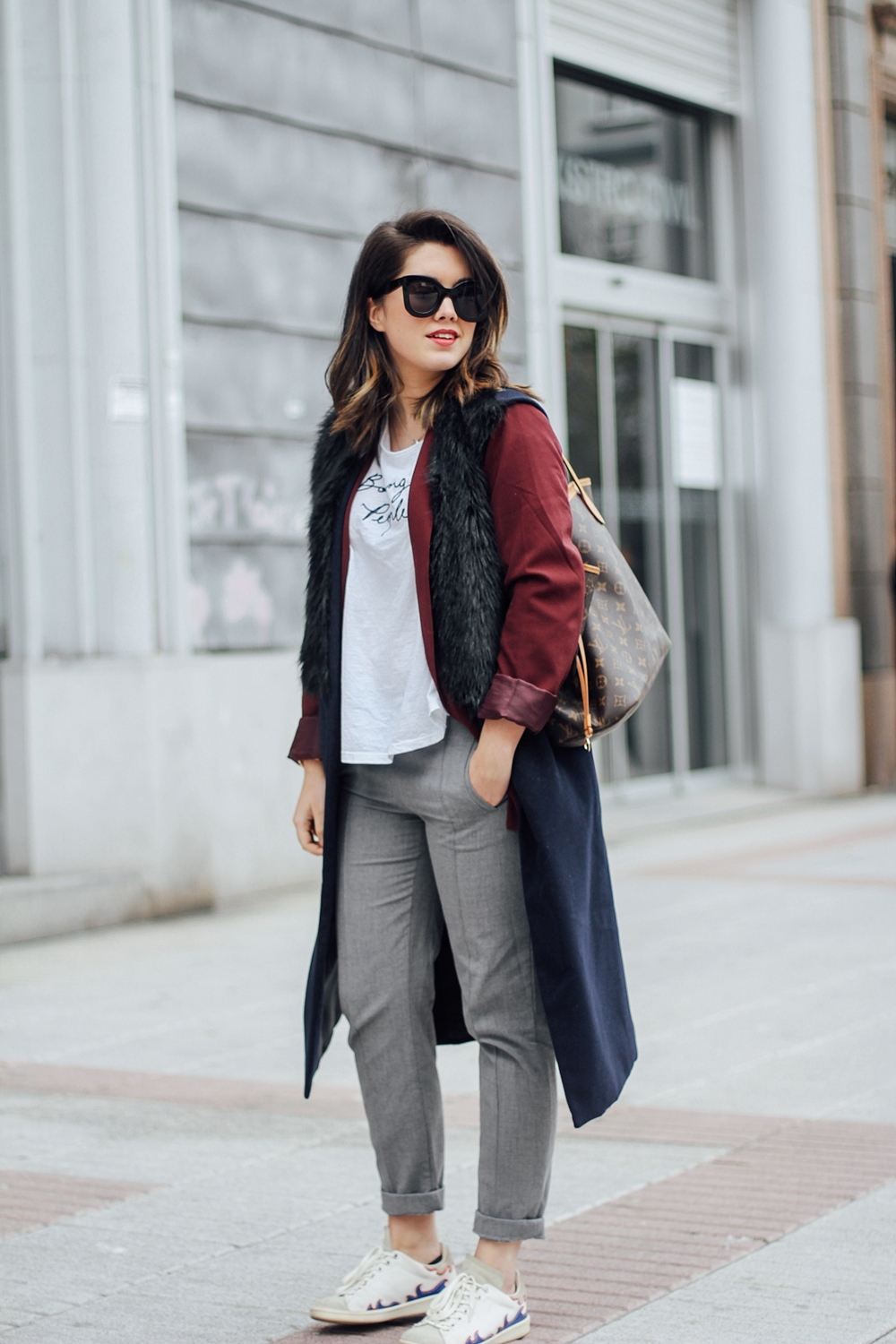 isabel marant sneakers with faux fur vest and red blazer streetstyle
