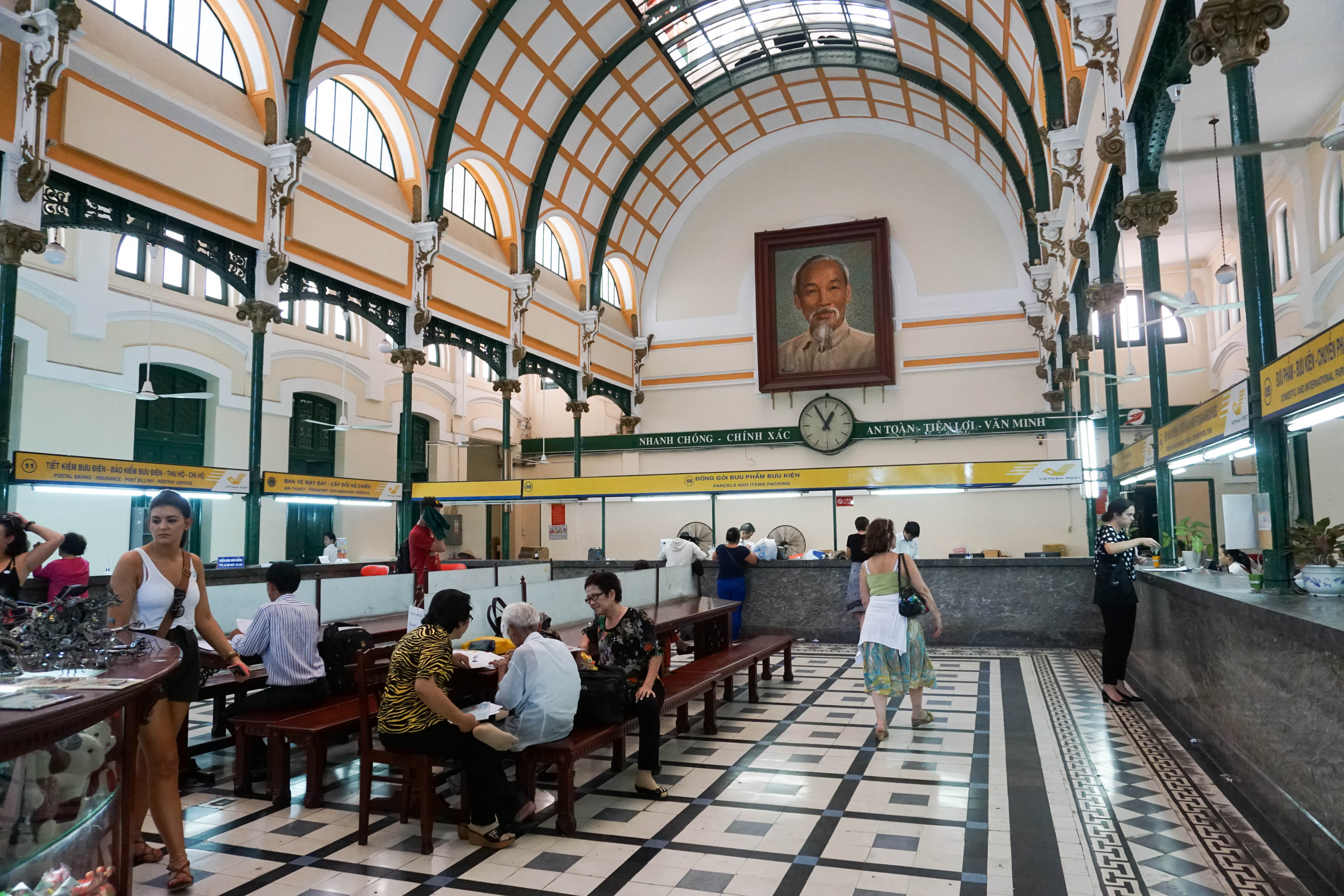Wood Desks and Benches and the Local Legend at the Saigon Central Post Office. Ho Chi Minh City, Vietnam, April 2016.