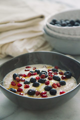 Blueberry and pomegranate porridge with greek yogh…