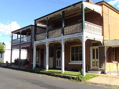 Millthorpe. Old terrace houses with iron lacework on their verandas.