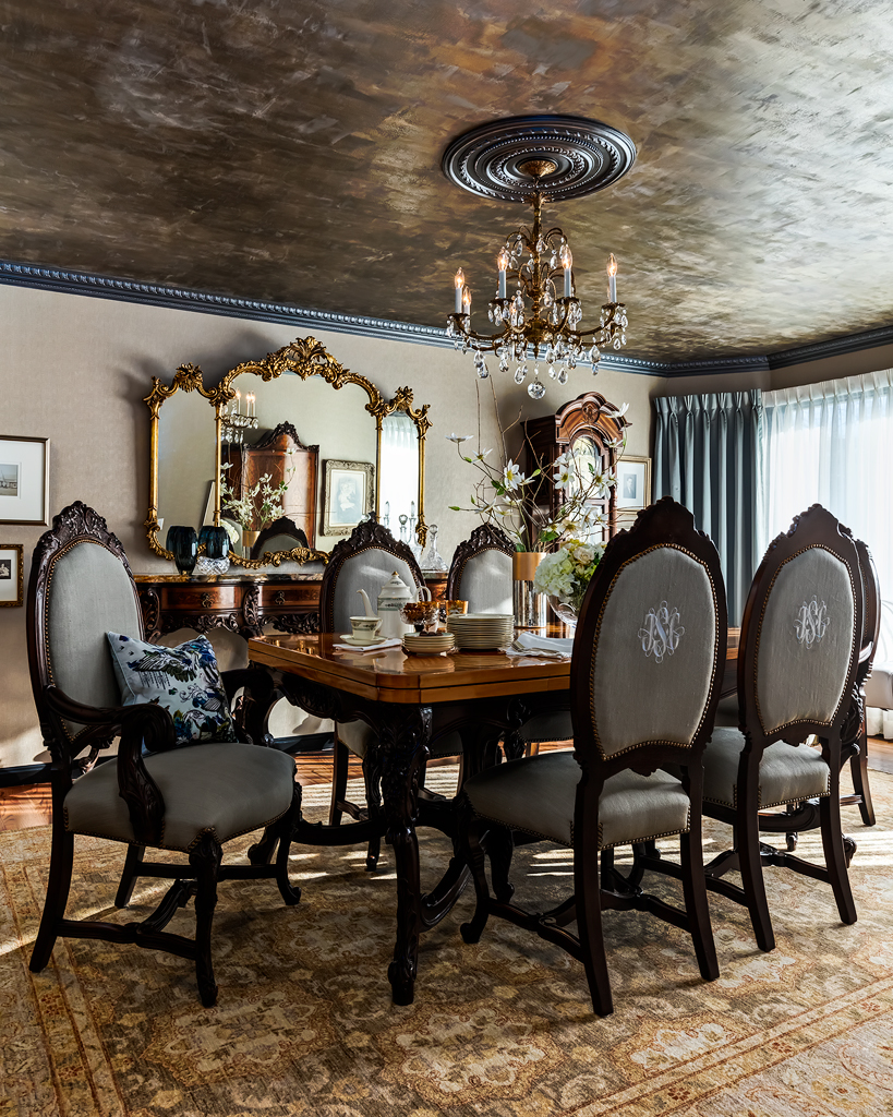 formal dining room with antique french set, hand painted ceiling, custom drapery and antique Persian rug