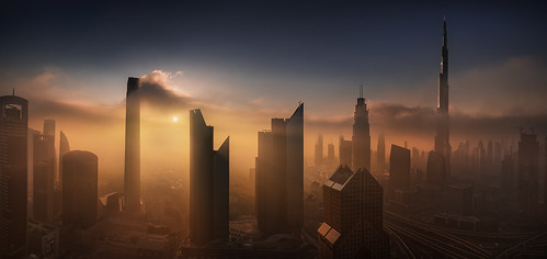 city blue panorama orange weather fog clouds sunrise dubai cityscape skyscrapers towers uae middleeast dramatic aerialview fantasy metropolis aerialphotography burjkhalifa