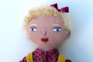 blond girl doll face