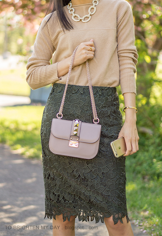 gold pave chain necklace, camel sweater, dark green lace pencil skirt, nude bag with studs