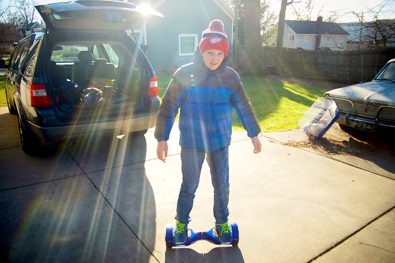 day 4192 - oh nothing, just odin riding a hoverboard for the first time ( with bonus lens flare ).