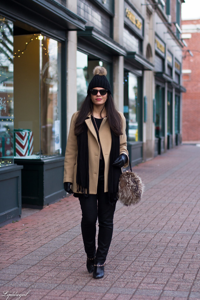 black jeans, black sweater, camel coat, fur pom hat-1.jpg