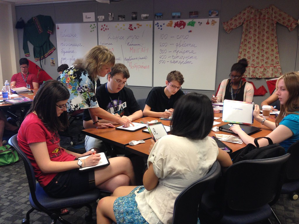 Instructor Tatyana Bystrova with Russian foreign language academy students practicing writing.
