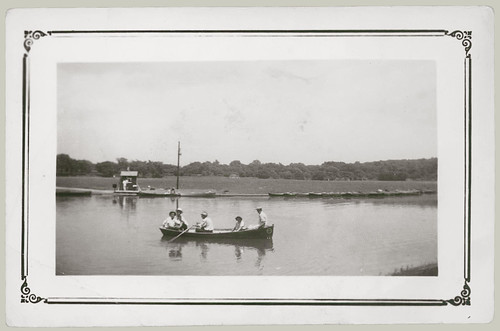 Four men and a woman in a boat