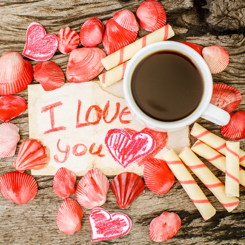 Valentines Day background with seashells, hearts and coffee