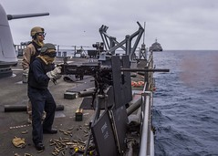 Sailors conduct live fire exercises aboard USS Port Royal (CG 73) as USS Coronado (LCS 4) transits behind during IDCERTEX. (U.S. Navy/MC3 Christopher A. Veloicaza)