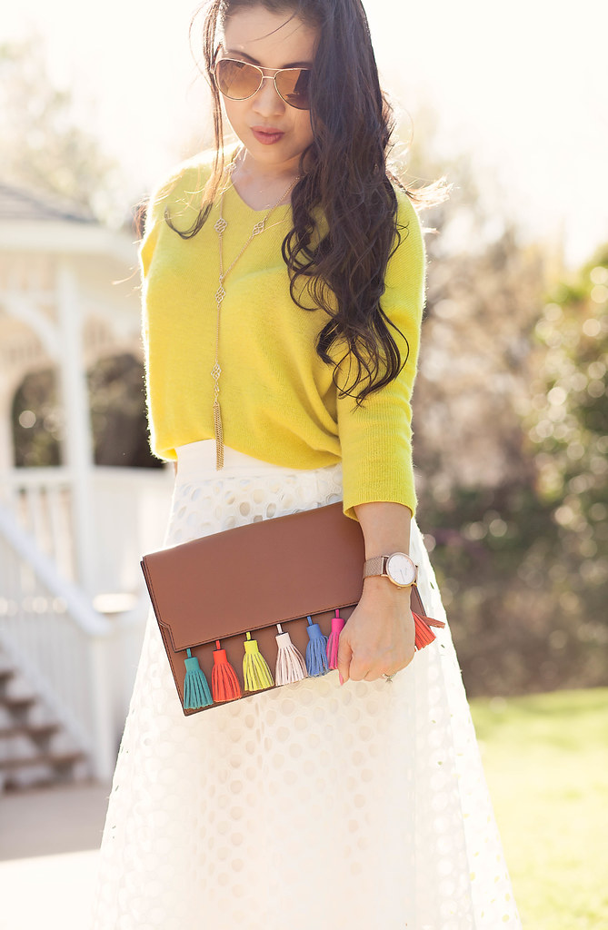 cute & little blog | petite fashion | yellow sweater, white eyelet midi skirt, minkoff sofia tassel clutch, cobalt blue suede pumps, socialite pink tassel lariat necklace, gold brown aviators, kate spade clover earrings | spring outfit